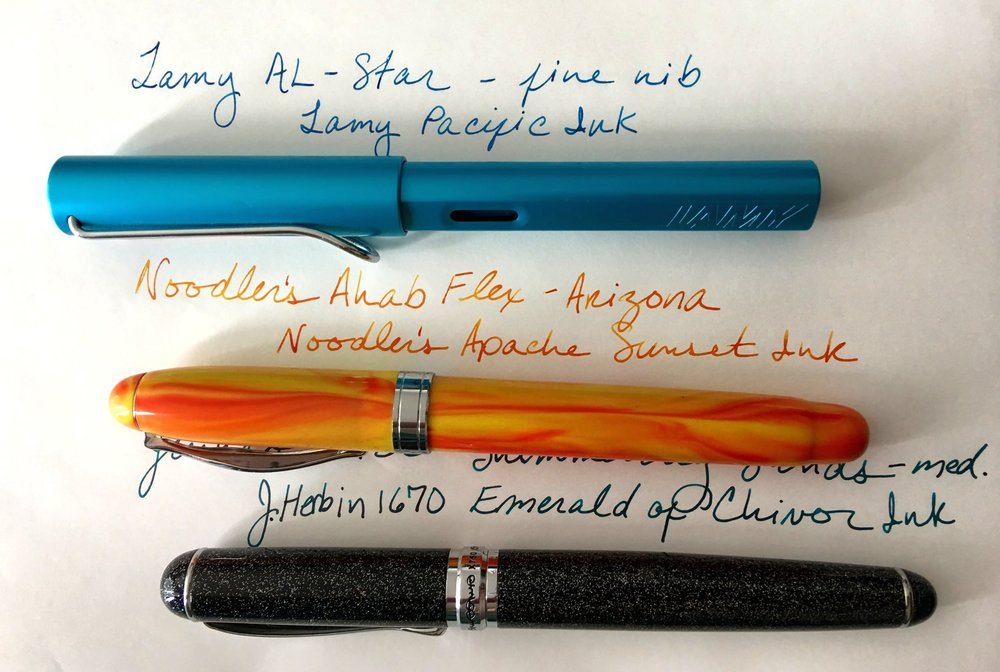 - Lamy AL-Star (fine), Pacific - This pen was originally a special edition, but they've added the color to their collection permanently! Available this month.Lamy Pacific (Turquoise) InkNoodler's Ahab Flex (Nib #6), ArizonaNoodler's Apache Sunset Ink.Jinhao X750 (medium), Shimmering SandsJ. Herbin 1670 Emerald of Chivor Ink. (Definitely view this sheening/shimmering ink!)
