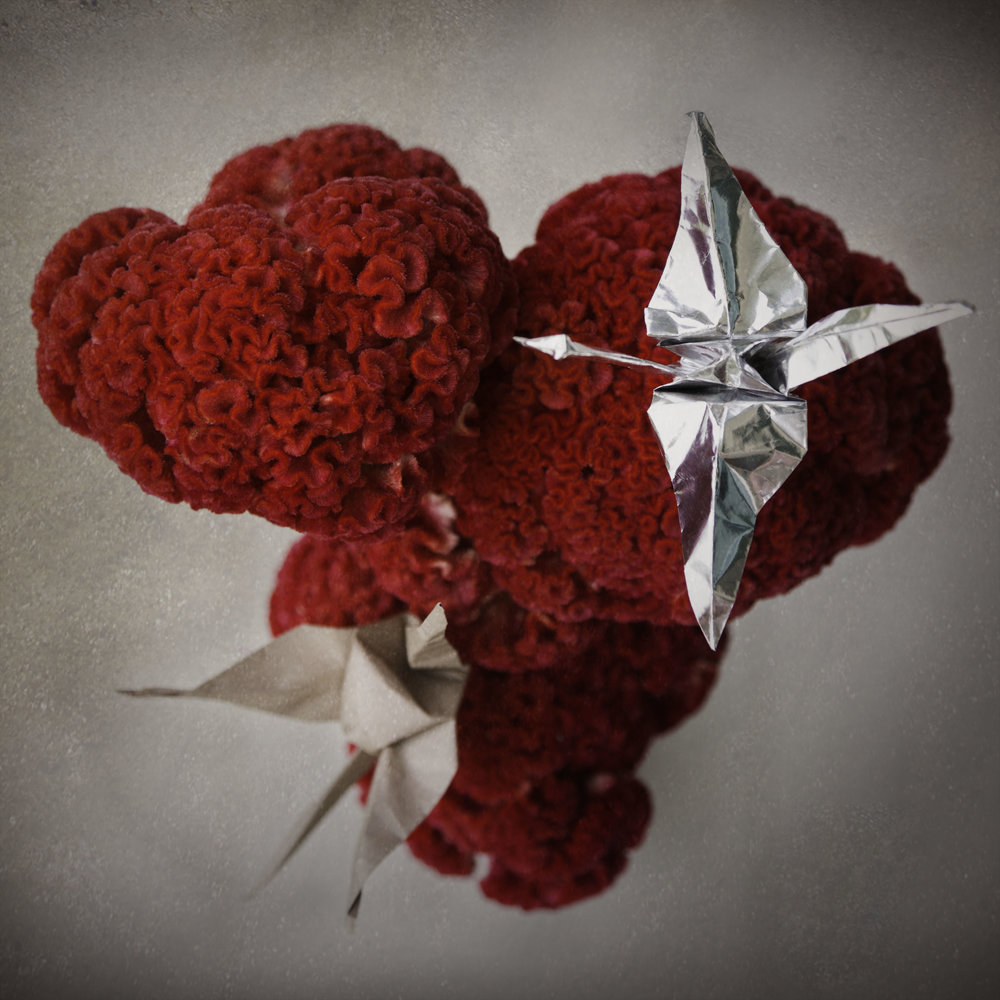 Handmade crane props made from traditional origami foiled and brown paper.