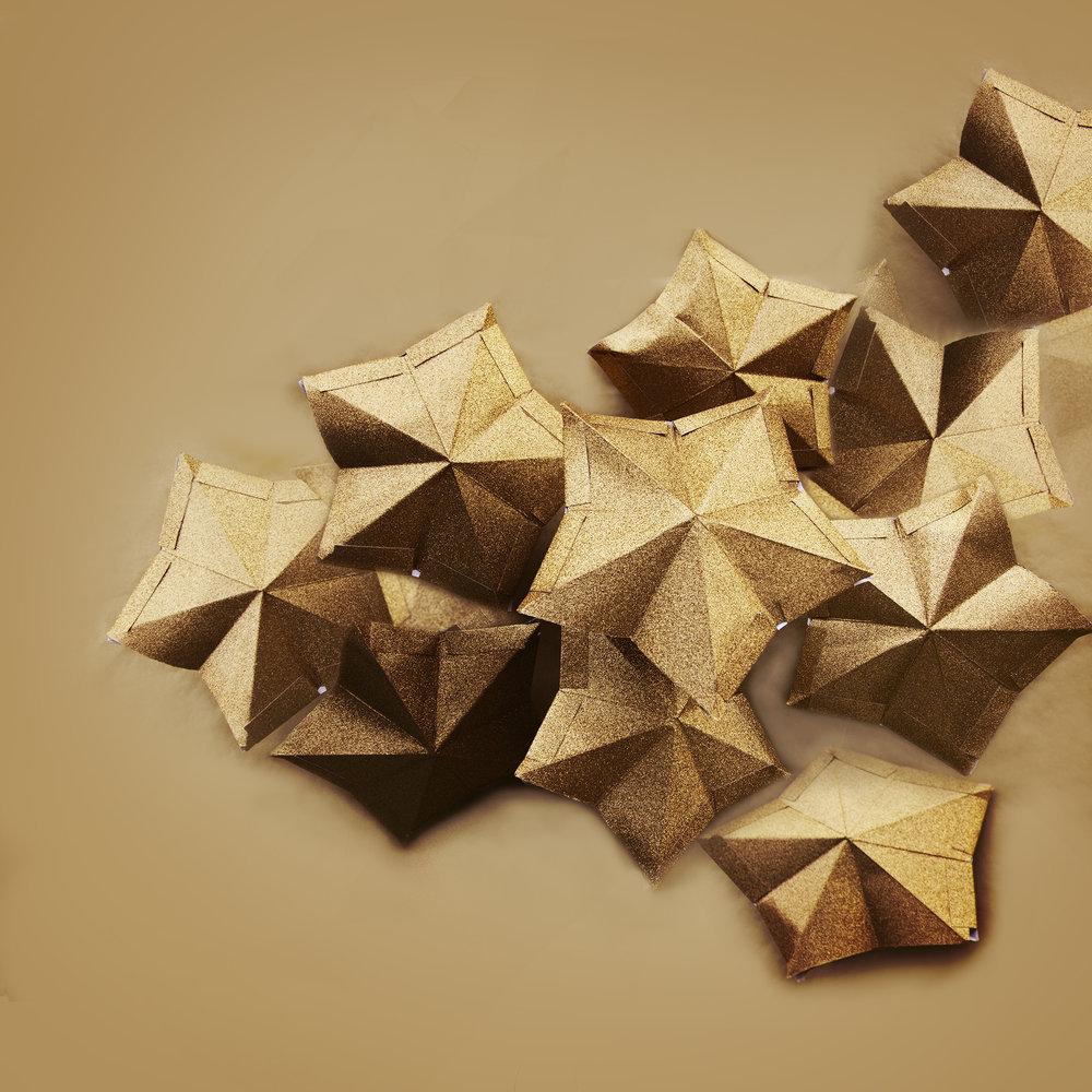 Handmade glittered card stars.