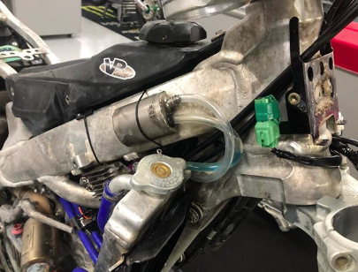 The aftermath of the race on a Monster Energy/Pro Circuit/Kawasaki KX250 race bike.
