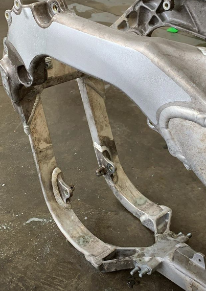 A look at the frame of a Monster Energy Kawasaki KX450 from the disassembly wash. Notice the discoloring to the aluminum.