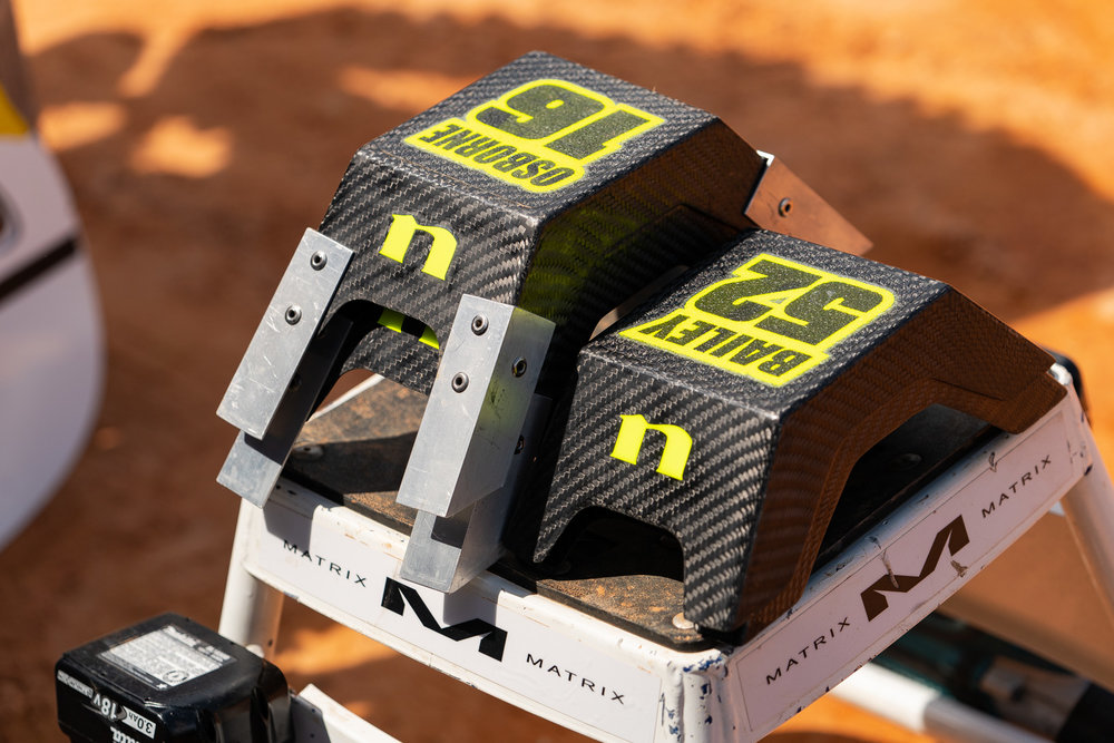 Sometimes we drool over the parts that teams have for their racers and wish we could get some of our own. Take these Nihilo Concepts carbon fiber starting blocks used by Jordan Bailey and Zach Osborne (ZO's have a few metal extensions to aid his stature). We saw these in use at the Minneapolis SX a few weeks back and couldn't get over how trick they were. As luck would have it, a set landed on swap's doorstep the other day and we're impressed at how strong the material is! If you've got a few hundred bucks to spend and a helper to retrieve these off the starting line for you, check out our product report on the main page.
