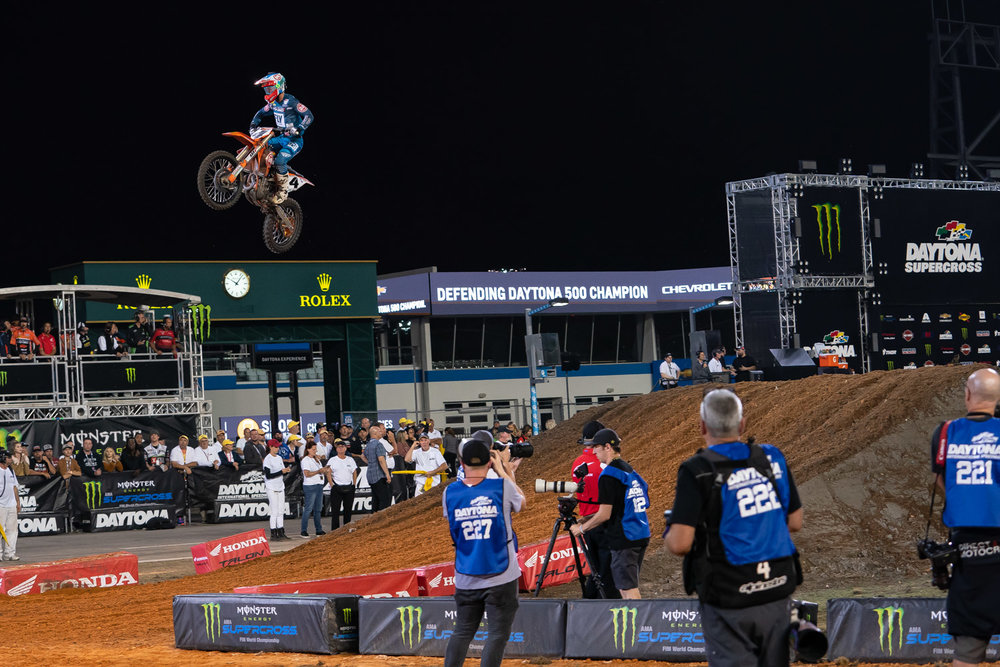 Boosted. Daytona almost always has a wall jump around the mechanic signal area and in 2019, we waited all day for someone to sky the single past their wrench. We had to wait until the opening laps of the 450 Main Event, when Blake Baggett rocketed up the face on his Rocky Mountain ATV-MC/WPS/KTM motorcycle and landed with a soft thud thanks to the WP suspension. Was it really the faster line or more of a mental play at the competition that he could do something new at any time? We're thinking it's a little of both.