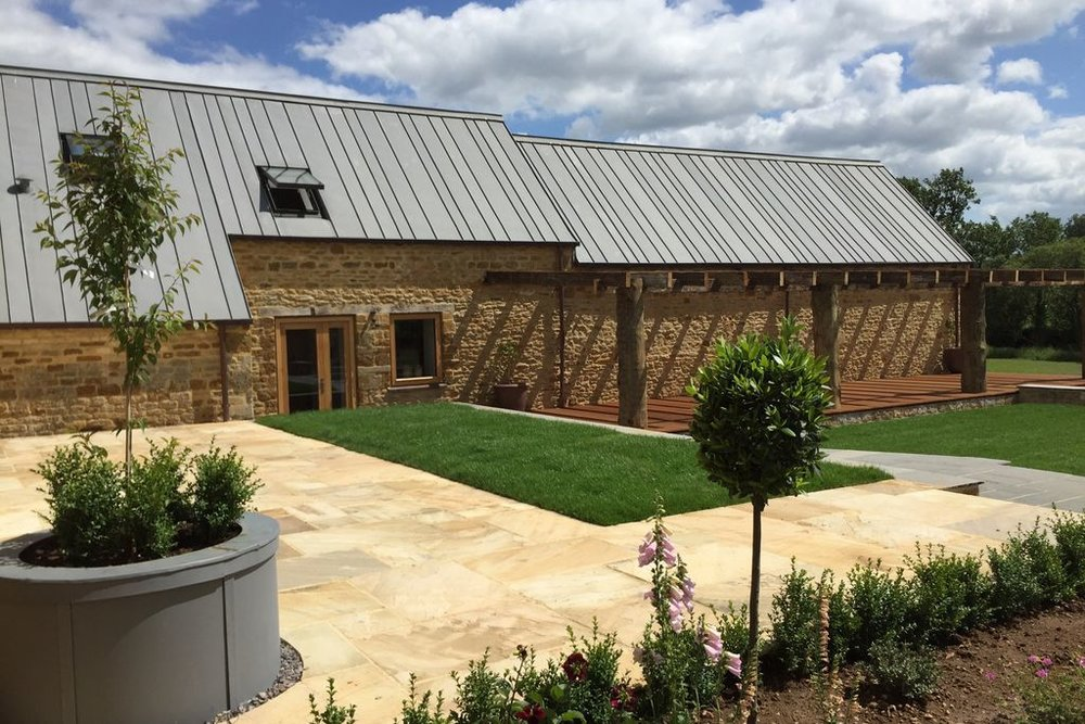GREAT TEW - Luxury in the cotswolds holiday cottages based in great tew. The renovation of great tew farm house and barns was completed in staggered bay widths using VM quartz zinc. The staggered bay widths gave this project a modern twist against the traditional stonework.