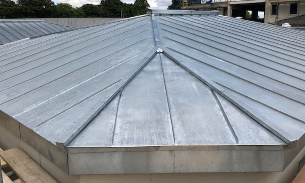 RADLEY SCHOOL - The large new science block at Radley boys school has both a natural zinc roof and sections of cladding. Standing seam bays used with a traditional details at the ridge and hips finished the project that will be completed in 2019.