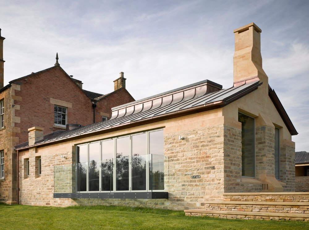 PRIVATE HOUSE GLOUCESTER  - A large stone orangery new build is finished with tecu oxid copper for a pre weathered look. The weathered copper gives an aged aesthetic to both the orangery and the garden room, as seen in the gallery below.