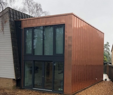 DENTON ROAD - Copper cladding is used along side anthra zinc in this simple design to give clean lines. with bronze copper capping to finish.