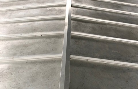 CHILDREY CHURCH - Here is just one example of where we have used stainless steel when replacing lead on a church roof. Using stainless steel to replicate traditional lead details, like the batten rolls.