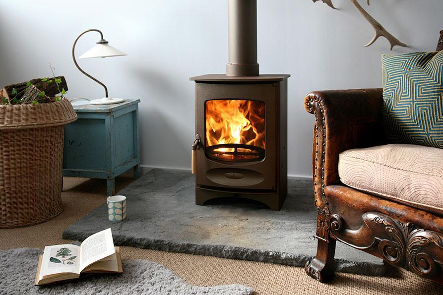 C-Four-woodburning-stove-in-bronze.jpg