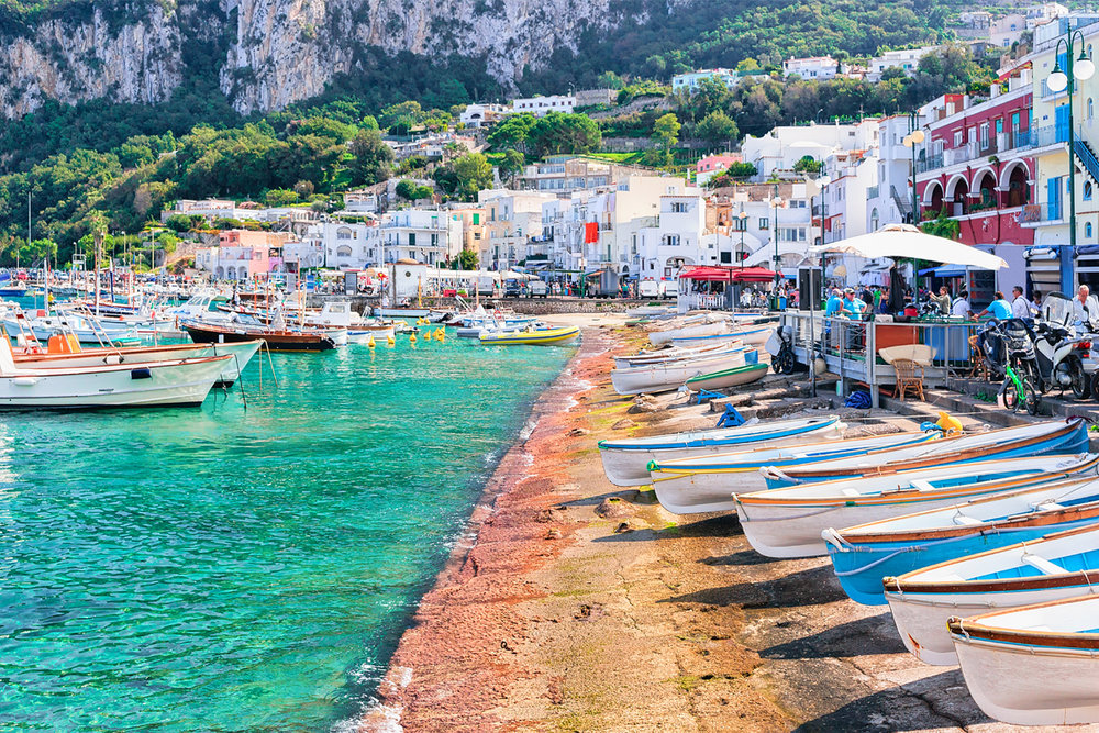 stock-photo-boats-at-marina-grande-embankment-in-capri-island-in-tyrrhenian-sea-italy-768479092.jpg