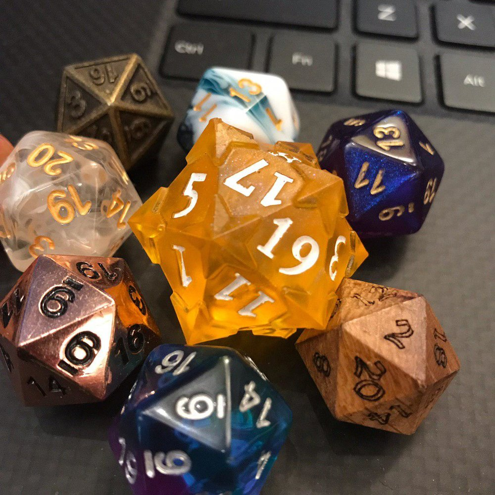 Some of my d20s! So far, I have dice from Finland, Hong Kong, Japan, New Zealand, and the USA.