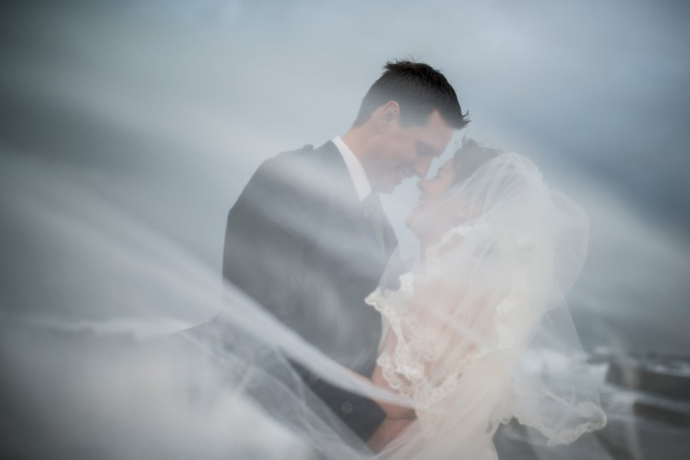 winter-weddings-northren-ireland-couple-on-beach-luxury-irish-wedding-photographer.png