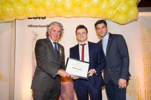 Conor receiving an Enactus World Cup Travel Bursary, sponsored by KPMG, from Enactus Ireland Chairman, Terence O'Rourke, and Bernard Brogam