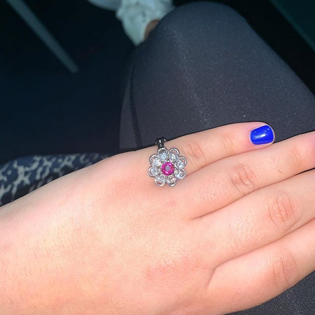 Custom refurbished ballerina ring with diamonds surrounding a center ruby