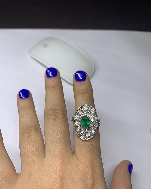 Gorgeous Art Deco ring. 3.5 ct of diamonds surrounding a stunning center emerald