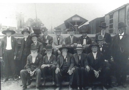 Pictured here standing on the back row, third from left is Charles Hicks posing with fellow veterans at the train station in Lyons, Georgia. This would be Charles' final trip to Gettysburg.