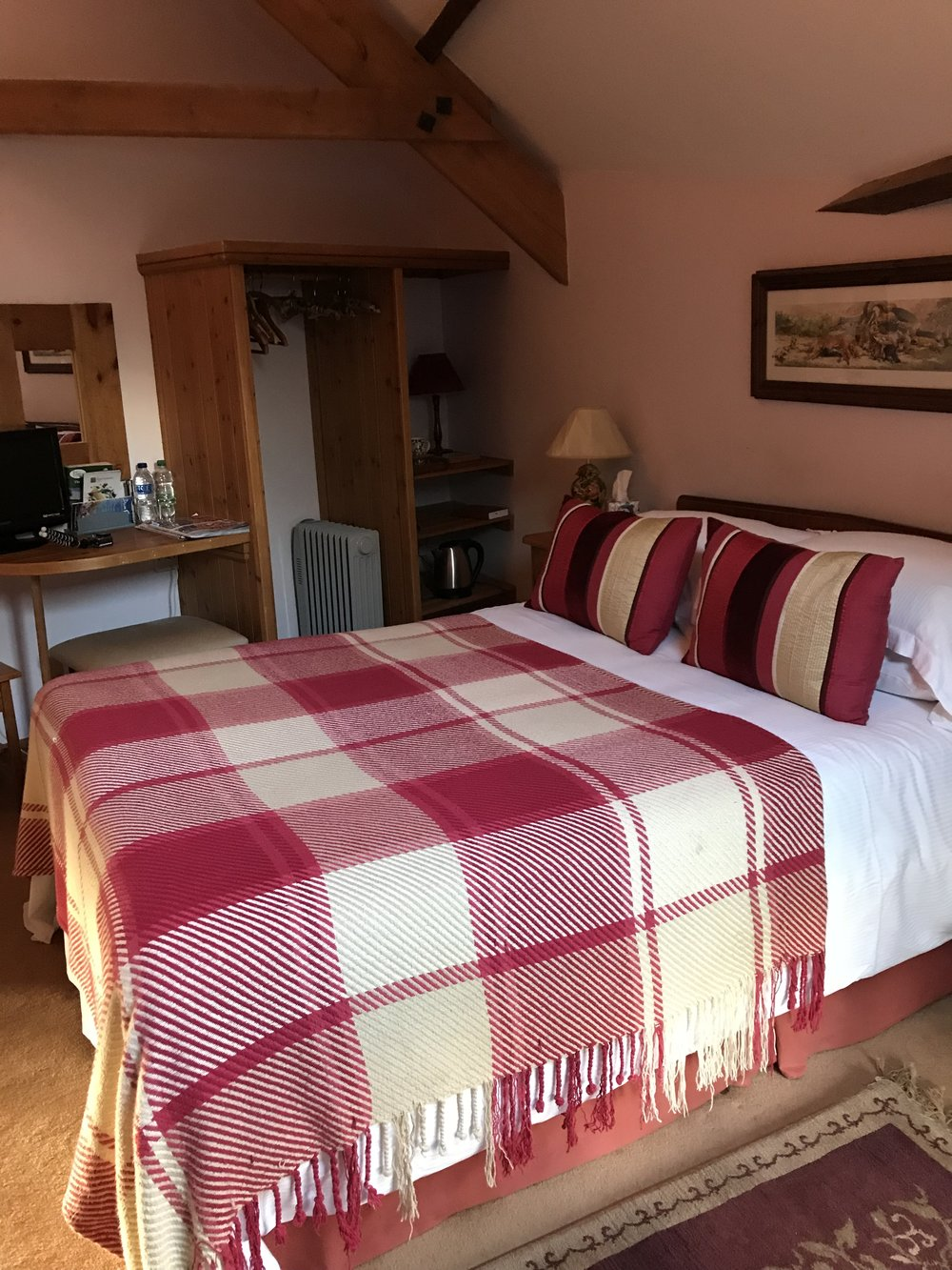 Cow Shippon Double - The Cow Shippon double room is framed by a beautiful open beamed ceiling complimented by an ensuite bathroom with a shower. The room facilities include a beverage tray, homemade biscuits and fresh flowers from the garden.