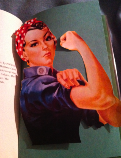 Rosie the Riveter on magazine paper, tucked in the back of a library book of just the right size.