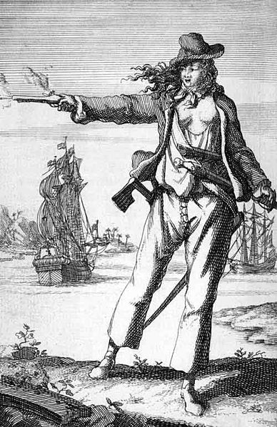 An engraved image of famous female pirate Anne Bonny, in men's clothing, firing a pistol and looking dashing while a galleon sails away in the background.