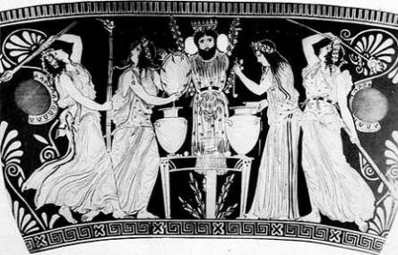 Black and white photographic image from an ancient Greek red-figure vase: several ladies in drapey clothing with loose hair cavort generally about, with the bearded limbless figure of Dionysus in the center.