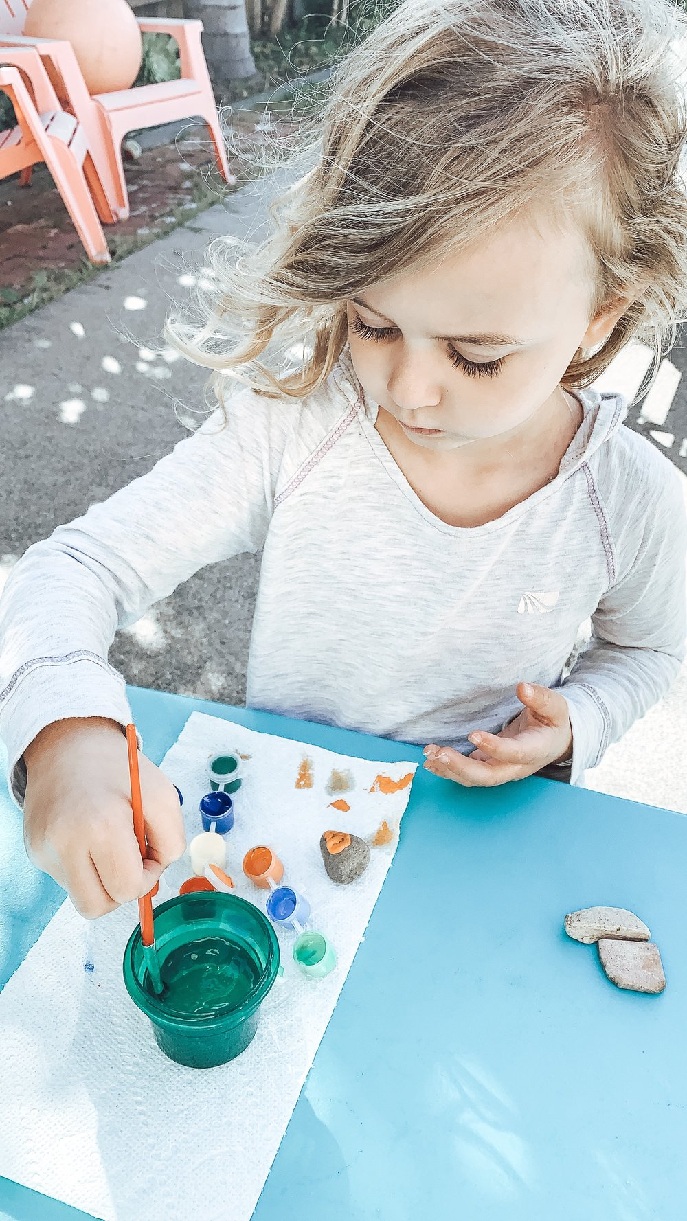Paisley was super into painting her rocks. We used cheap paint sets from the dollar store and they worked like a charm!