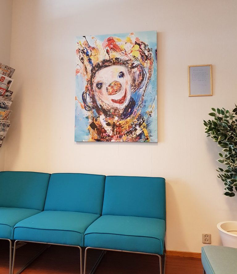 The art in my dentist's waiting room: Monkey? Child? Clown? At least it's not scary