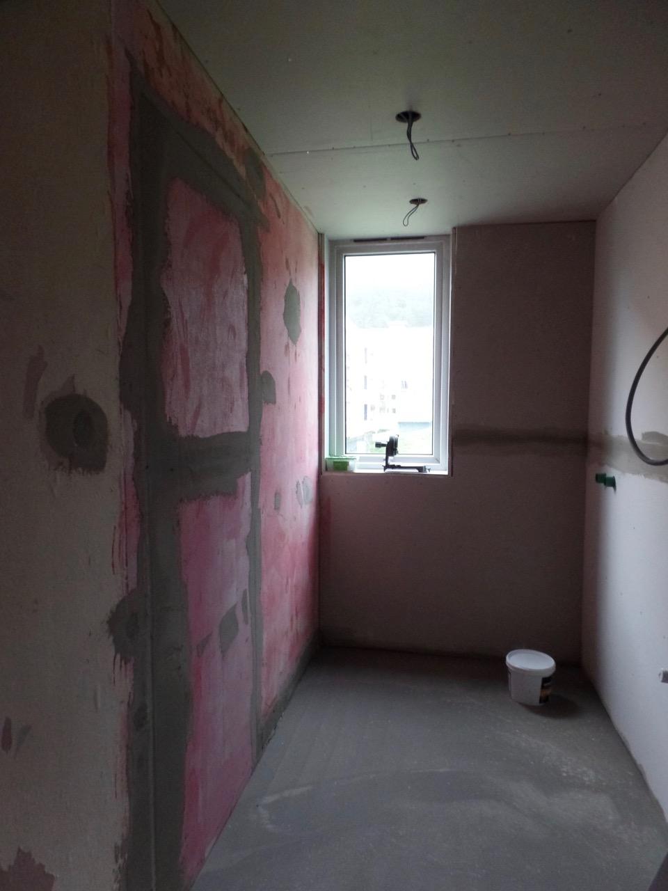 Doorway to bedroom sealed; heating laid in floor