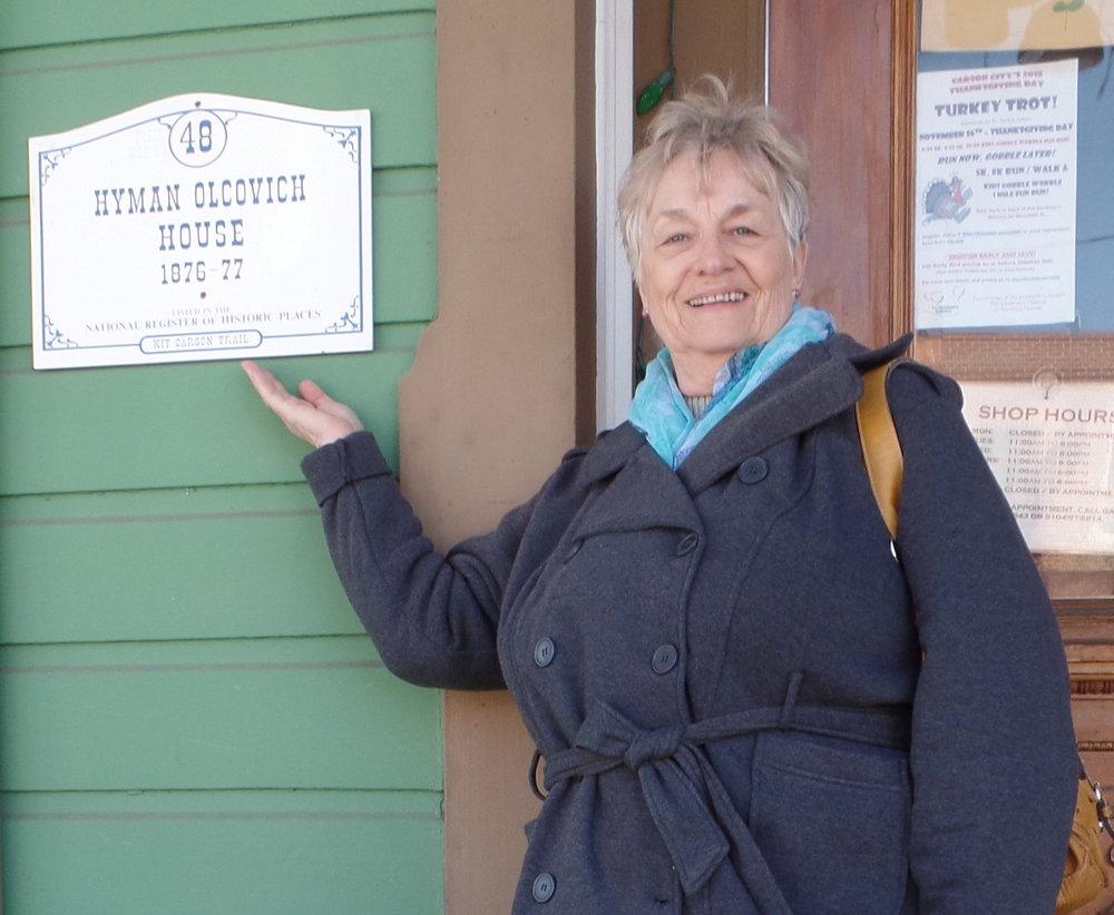 Mom showing signage she designed