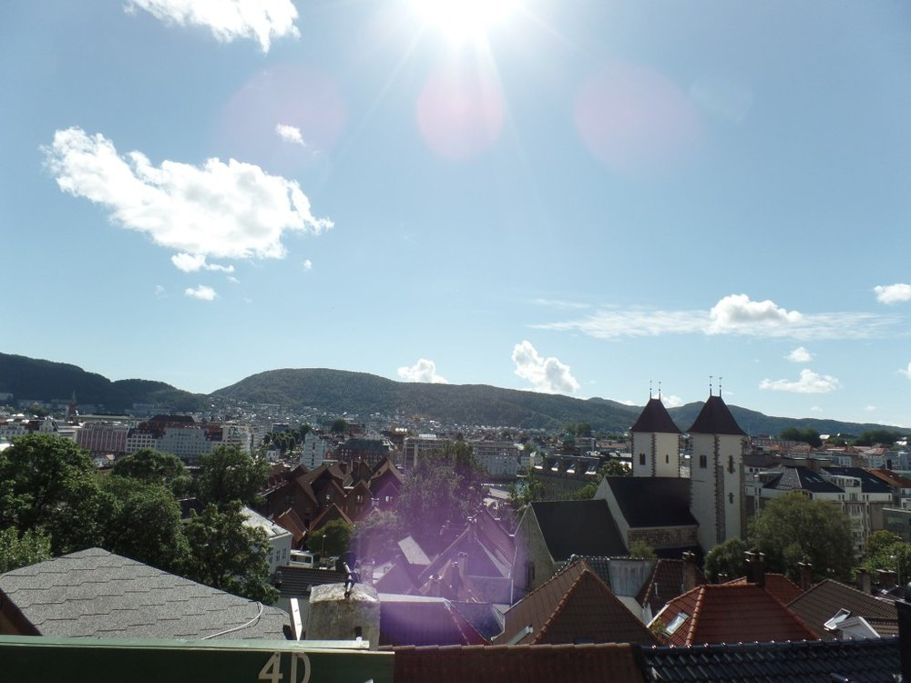 Bergen roofs in sunshine and Mariakirken