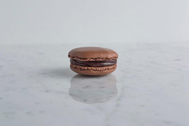 Imagine eating the best rich dark chocolate brownie you can imagine... that's what a bite into our dark chocolate macaron tastes like. With a dark chocolate ganache as its center and cocoa powder in the cookie, this macaron is one of our all time faves. And if you love chocolate, you'll love this one!