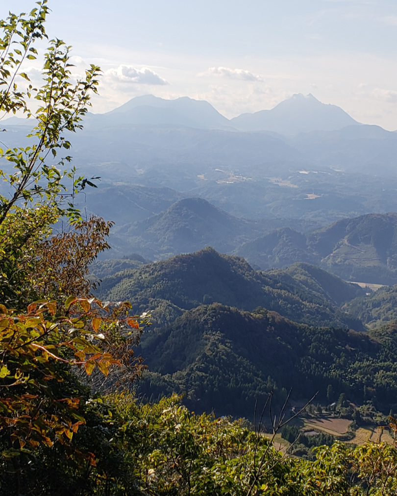 A far-away view of Yufu-dake. It's the distinctive notched one on the right.
