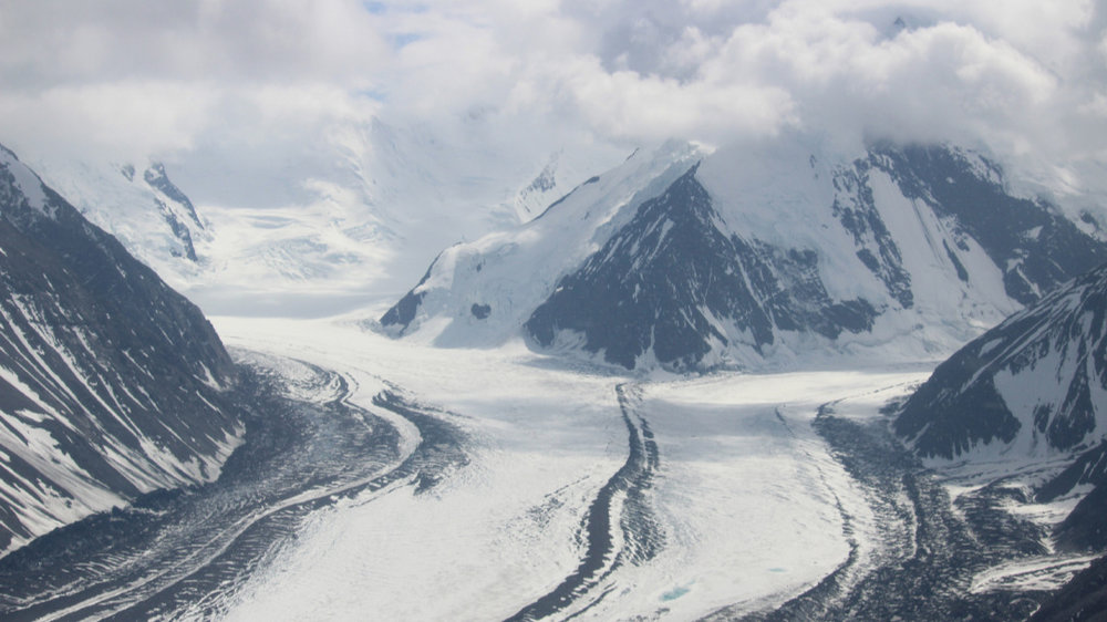 Two glaciers joining, with the medial moraine inbetween