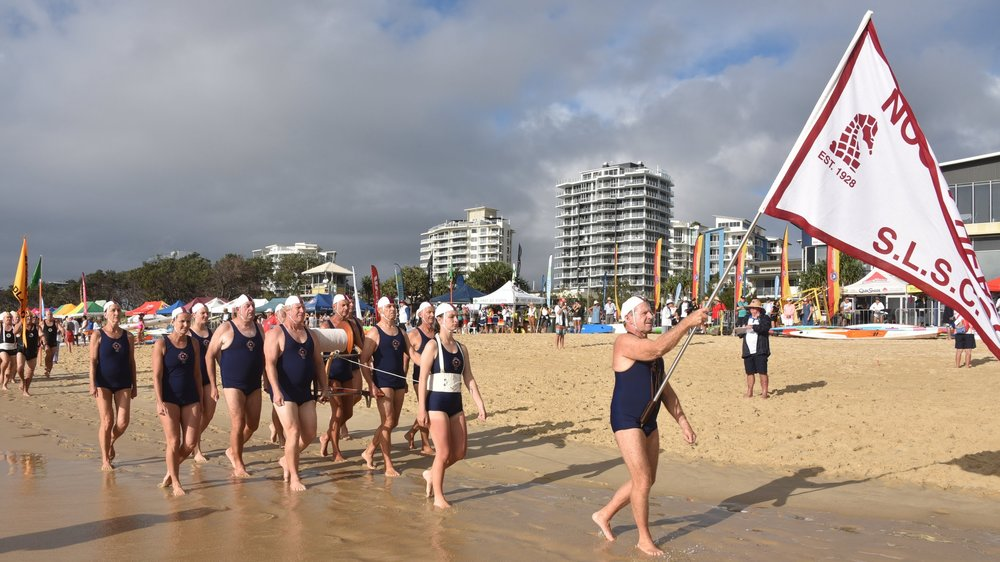 MARCH PAST - The March Past has been part of the surf lifesaving movement since the beginning of competition. Dressed in traditional club uniform, lifesavers march in time to music around a set course carrying a surf reel, line, and belt. Teams are judged on a number of factors including timing and presentation.