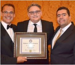Tony Viazis (left), the inventor of  FASTBRACES® , presenting Stephan van Vuuren (middle) with the Senior Master Provider award in Dallas in 2016. On the right is Evangelos Viazis, who has done some magical work with  FASTBRACES®  in his practices in Athens.