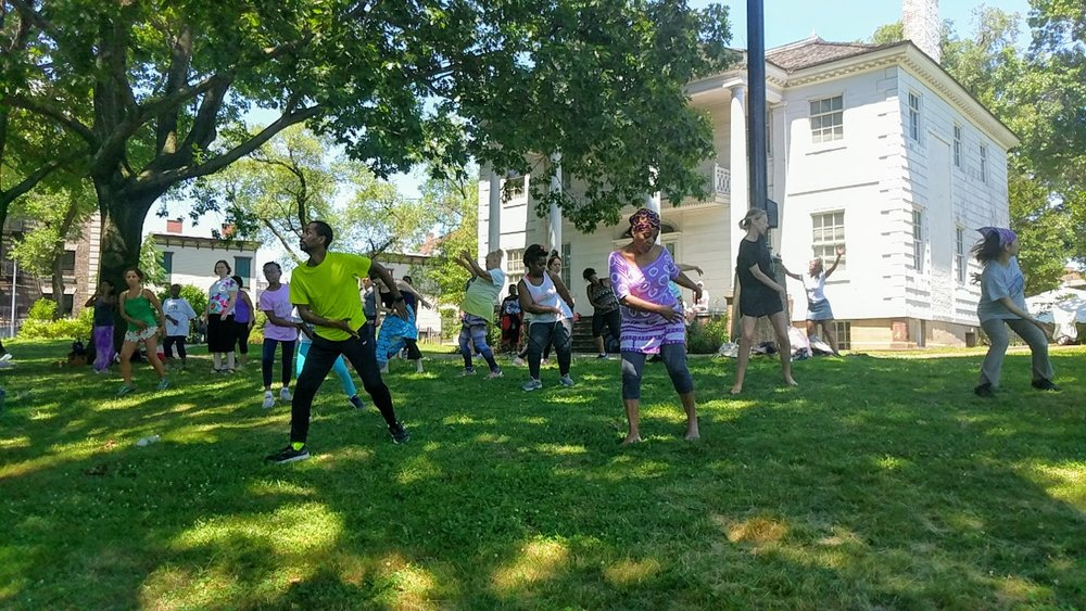 Participants enjoying a free session of African dance class led by instructor Yahaya Kamate.