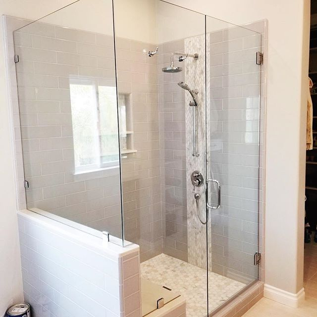 Loving this bathroom remodel we where able to help out with. This clear shower glass is all that's needed with such a beautiful tile job. We also installed the mirror with a beveled edge to bring some more dimension to the room. Overall great work from the team here at Sea Breeze Glass! Call us today and let's get designing your dream shower enclosure.