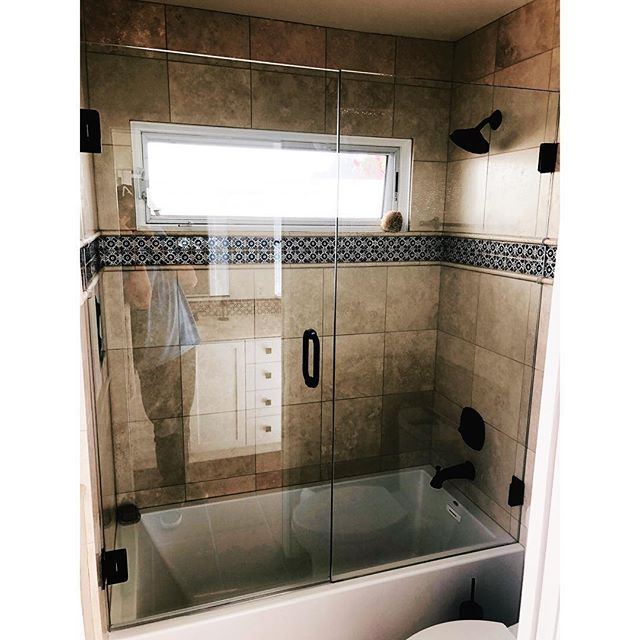 What a great look for this tub enclosure. Classic clear glass is underrated when it comes to some shower installs. It's a great way to showcase your tile. #sandiego #showerglass #homeimprovement #sandiegocontractor #construction #bathroomdesign #bathroomremodel