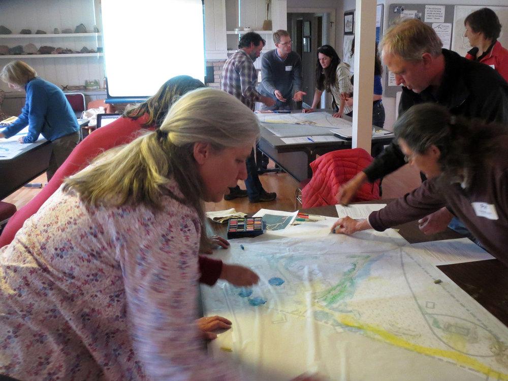 Lake Superior Stewardship Initiative (LSSI) members, designing (Nancy at upper right)