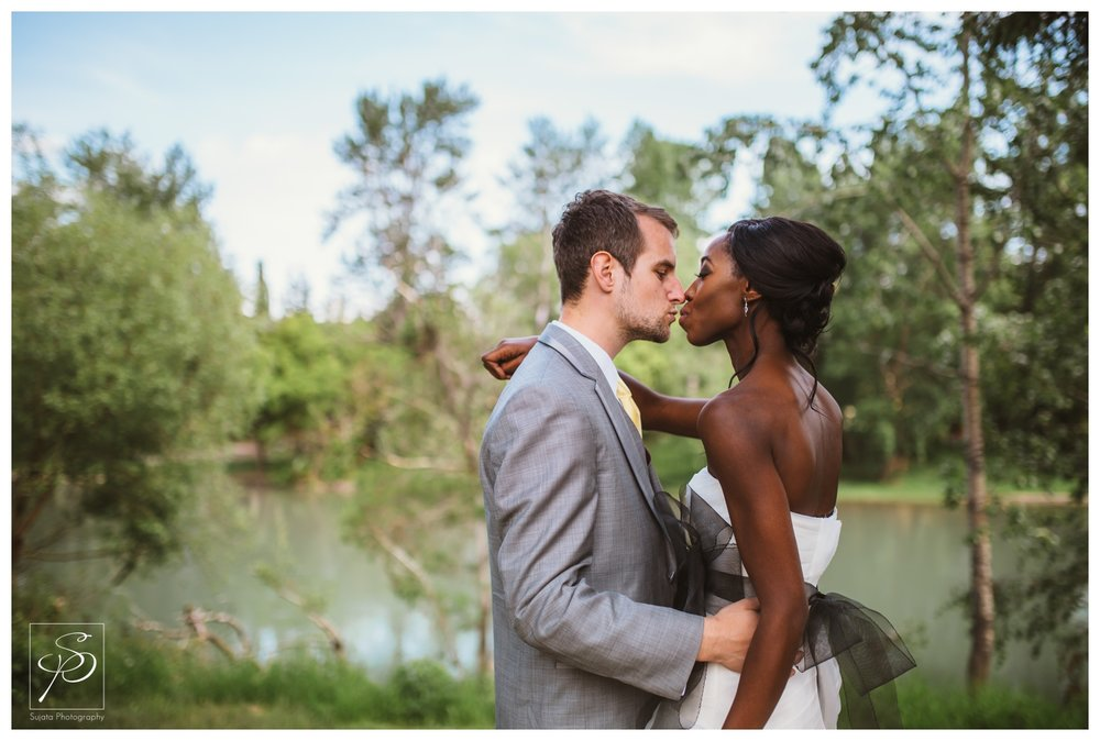 Bride and Groom by Elbow River in Woods Park Calgary wedding photographer Crystal Sujata