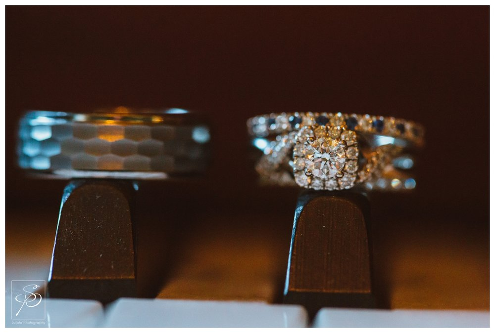 Wedding rings on piano keys at Lougheed House Calgary