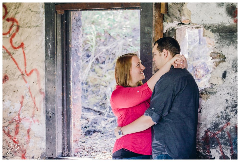Couple embracing in a building by the Canmore coal mines