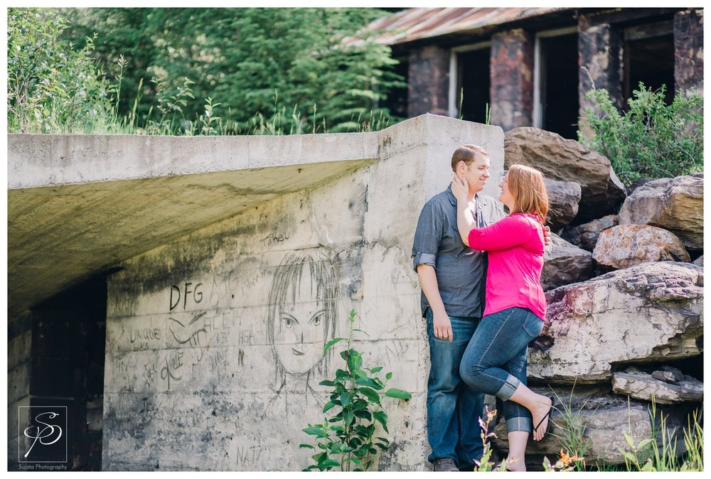Couple posing next to a mine shaft in Canmore, Alberta