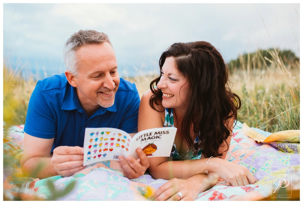 Couple reading a book during their engagement session