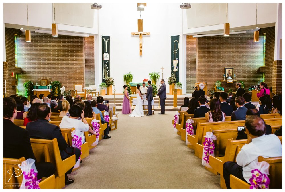 Bride and Groom exchanging vows during Catholic Ceremony Calgary