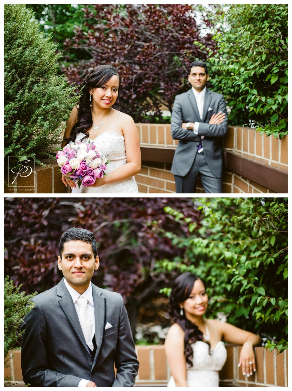 Bride and Groom posing for photos after their Catholic Ceremony Calgary