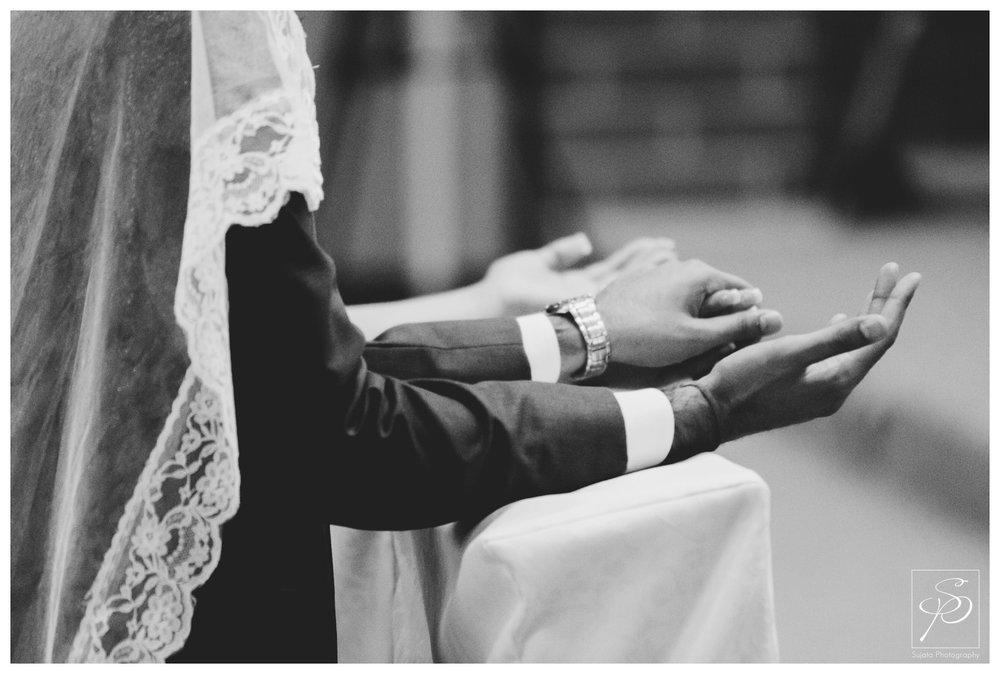 Bride and Groom holding hand during Catholic veil ceremony Calgary
