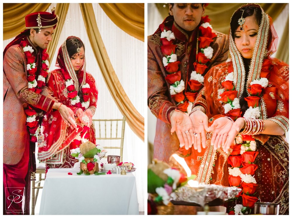Bride and groom circling sacred fire during HIndu wedding ceremony Calgary