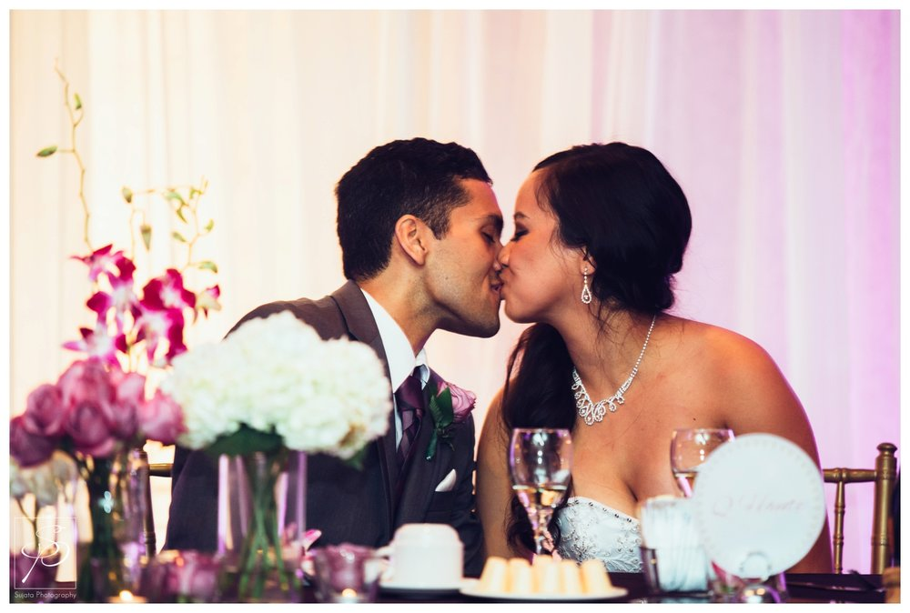 Bride and Groom kissing during wedding reception Calgary