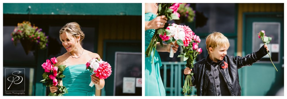 Bridesmaid handing out roses during Lake Louise wedding ceremony