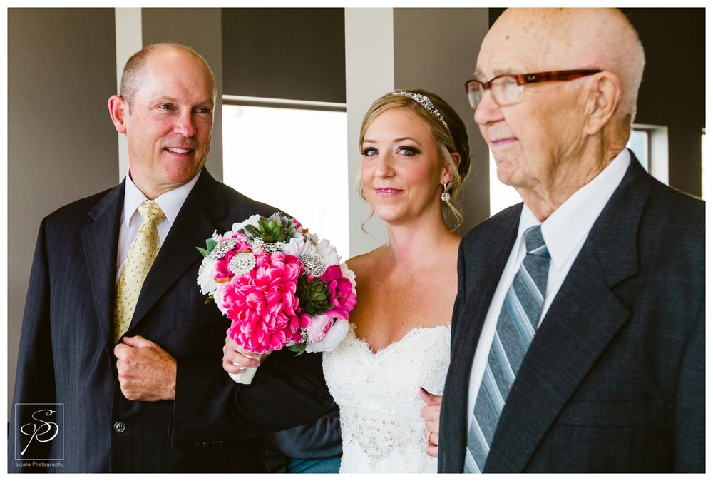 Bride waiting to walk down the aisle with Father and Grandfather
